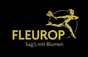 Das Logo von Fleurop mit Firmennamen in gold auf schwarzem Hintergrund